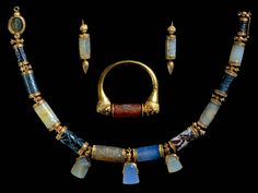 Jewellery belonging to Lady Enid Layard made from ancient cylinder-seals from Mesopotamia (ranging from 2200 and 350 BC, Akkadian, Assyrian, Babylonian and Persian) in Victorian gold setting (British Museum)