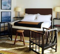 Robert Stilin - what about those patchwork landscape paintings in a guest room with upholstered headboard?