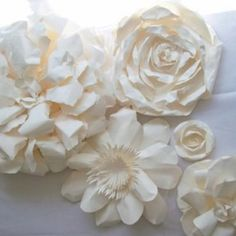 paper wall flowers diy | Design a wall with paper flowers or put in your Christmas tree/garland