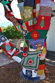 A #Christmas-sweater yarn bombing