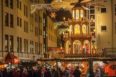 """A giant sized """"pyramid"""" replicates the traditional table-top Christmas decoration in Germany. Berlin.  Pinned by www.mygrowingtraditions.com"""
