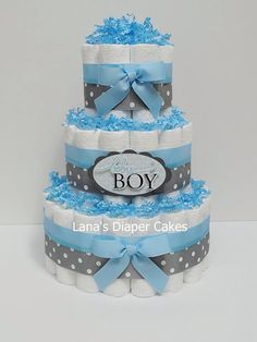 Baby Boy Blue And Gray Diaper Cake Baby Shower Centerpiece by LanasDiaperCakeShop on Etsy https://www.etsy.com/listing/158238505/baby-boy-blue-and-gray-diaper-cake-baby