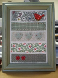 ........3 hearts, two flowers and a little birdie handmade fabric picture in a painted charity shop frame