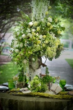 Beautiful tablescape and floral arrangement. Just says summer decorating to me. Love  this woodland look with the moss and birch like vase.