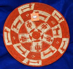 """Such a pretty basket! Finely handwoven with thunderbirds and deer characters. Measures 14 in diameter x2.5"""" Use it for fruit or party snacks, or hang it on your wall as a decorative accent. $24.95 #basket #handwoven #southwestern #homedecor"""