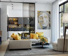 Let's begin our exploration of yellow decor with an especially strong example. This artistic home features smartly-arranged yellow accessories, a great way to spice up the gray sofa and open kitchen shelves. The painting ties the theme together. Saved from:http://www.home-designing.com/category/living-room-design