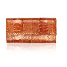 Okapi Women's Wallet / Burnt Amber Ostrich Shin, Gold Hardware ($425) ❤ liked on Polyvore featuring bags, wallets, burnt amber ostrich shin, stitch bag, zip wallet, zipper bag, zipper wallet and zip bag