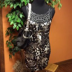 🍂STUDIO Y ANIMAL PRINT DRESS/TUNIC🍂 Hot little dress/tunic in a bold animal print with a metallic sheen to the material.. Very stylish. Great alone or with leggings Studio Y Dresses