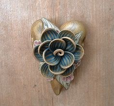 Blue Flower on Gold Heart Bead by ZudaGay, via Flickr