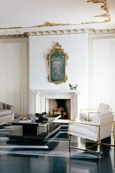 When interior designer Catherine Kwong created the living room of the 2013 San Francisco Decorator Showcase, she sourced the antique gilt mirror was specifically to echo the ceiling's fine gold detailing.  Photo by Bess Friday.