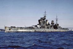 Battleship HMS King George V returns to home waters at the end of WW2. King George V flew the admiral commanding Home Fleet pendant throughout the war. She bears the marks of having fought through many a rough sea during the war years.