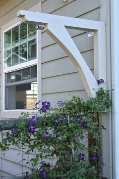 Laundry Line corbel bracket attached to side of house (image via Homestead Revival blog)