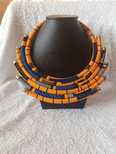 Check out this item in my Etsy shop https://www.etsy.com/uk/listing/565980860/african-print-necklace-statement