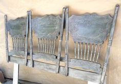Old chair backs mounted together make a unique headboard!