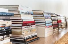 Organization idea: Stack books horizontally to switch up your library display! Tour more of Sara Ruffin Costello's Striking and Stylish New Orleans Home on Our Style Guide here.