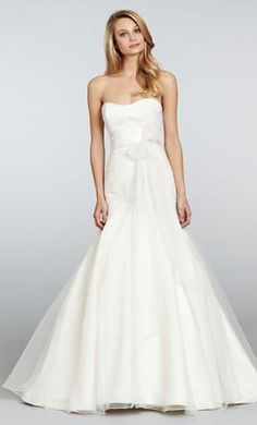 Jim Hjelm 1306//Size 12 - Ivory fit to flare strapless bridal gown with metallic lace elongated bodice over sparkle tulle and organza skirt, and chapel train.