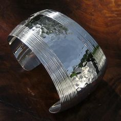 """""""Thunder"""" Silver Cuff Bracelet - A sparkling display of rumbling thunder comes bursting over and around this spectacular design. The artisan has created something of a dramatic drum beat of Silver that begins small and finishes with a bursting of brightness on the wider side of the piece. You'll really love the contrast of the inlayed Silver wire with the hammered treatment swooping over your wrist. A masterpiece! Drums Beats, Cuff Bracelets, Bangles, Sterling Silver Cuff, Thunder, Diy Fashion, Jewerly, Contrast, Cuffs"""