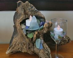 Fun use of a driftwood piece..., turned into a candle holder for faux tea lights, with added seaglass.