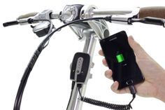 Use the BioLogic ReeCharge PowerPack to save the energy from your bicycle hub dynamo to charge your phone. It can also be charged directly from a standard wall outlet. http://www.thinkbiologic.com/products/reecharge-power-pack