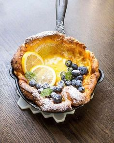 Mini Dutch Babies with Lemon Curd and Blueberries These mini Dutch Baby pancakes are puffy and beautifully golden brown. They're just right for breakfast, brunch or dessert. We filled ours with homemade lemon curd and fresh blueberries. Just Desserts, Dessert Recipes, Lemon Desserts, Lemon Recipes, Easy Recipes, Amish Recipes, Dutch Recipes, French Food Recipes, Dutch Desserts