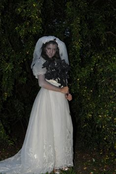 Corpse Bride costume.  Thrift store wedding dress and shoes (can find free or very inexpensive wedding dresses on Craigslist too), bachelorette veil from the party store, dollar store fake roses (spray painted black with a dollar can of spray paint), rubber spiders and rats pinned to dress & veil.  Total cost was approximately $30 - most expensive part was the party store veil which was almost nine dollars.