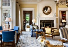 Bunny Williams. A blue and white decorative rug in an antique dhurrie pattern brings a feeling of home to this East Hampton retreat. Image courtesy Bunny Williams.