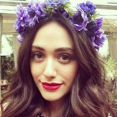 Emmy Rossum looking GORG in a floral crown and bright lip