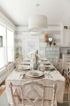 Dining area designed in all creams. traditional chairs in cream blend harmoniously with modern fixtures and walls. Just goes to show how eclectic you can be when you stick to a neutral color scheme.