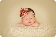 I'm loving this flowery headband on a sweet baby girl.