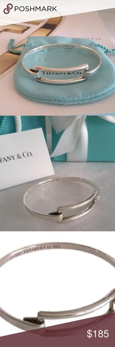 """Tiffany & Co Rectangle Cuff Bangle Bracelet Bangle Tiffany & Co Sterling Silver Rectangle Bangle Bracelet  Bangle inside measures 6.5""""  Rectangle section measures 1.39"""" x0.48""""  Sterling silver bangle Pre-owned, in good condition, please refer to pictures Stamped (c) 2003 TIFFANY & Co. 925   *PS: Tiffany & Co gift set for display only, NOT included with the item. #STN100/BX Tiffany & Co. Jewelry Bracelets"""
