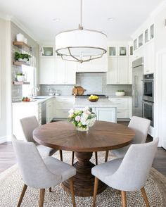 What's getting us through our Wednesday? This all white kitchen with rustic wood accents! Designed by @tracylynnstudio and photographed by @ryangarvin. Check out our Frida Classic Dark Oak Round Dining Table when you shop the look with our link in profile! #kathykuohome #interiordesign #rustic #whitekitchen #woodaccents #homedecor #kitchendesign #designinspiration