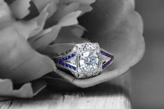 Diamond and sapphire mounting in 14K white gold.