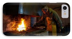 The Torresta Blacksmith  The Torresta Blacksmith heating the iron in the pit coal fire in Uppland, Sweden