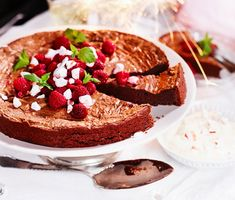 Chocolate cake with raspberries and cream polka