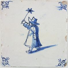 Antique Delft tile with a child playing with a miniature windmill, 17th century