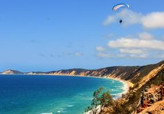 Rainbow Beach, QLD Australia I have been here and swam in the ocean. :)