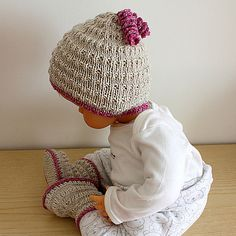 Free Pattern: Stream Baby Hat by Julia Noskova Love the pin tail.