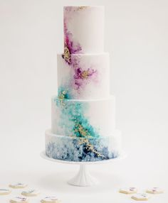 Watercolour wedding cake with gold leaf detail by Claire Owen Cakes. Photo by Claire Graham Watercolour wedding cake with gold leaf detail by Claire Owen Cakes. Photo by Claire Graham Creative Wedding Cakes, Floral Wedding Cakes, Elegant Wedding Cakes, Beautiful Wedding Cakes, Wedding Cake Designs, Beautiful Cakes, Elegant Cakes, Wedding Flowers, Geode Wedding Cakes