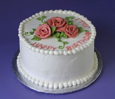 6-inch red velvet cheesecake cake with cream cheese frosting and buttercream decorations (recipe from here) the cream cheese frosting is pretty soft so i made up some buttercream for the flowers and the words. it was still not as stiff as my class b