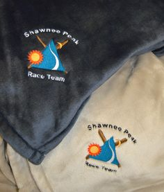 Shawnee Peak logo embroidered on our Luster Loft Patriot Blue and Light Gray throw blankets. http://www.shawneepeak.com/