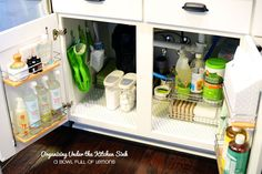 Under sink storage ideas. Look and learn plenty under kitchen / bathroom cabinet sink pull out organizer / storage for you to try + BONUS TUTORIAL. Under Kitchen Sink Organization, Under Kitchen Sinks, Kitchen Sink Faucets, Kitchen Storage, Home Organization, Storage Spaces, Storage Ideas, Ikea Under Sink Storage, Organize Under Sink