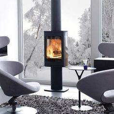With superb contemporary styling, the Duo 1 wood burning stove features a Pedestal base and a large glass door and side windows that provide breathtaking flame views. Stove Fireplace, Fireplace Design, Boiler Stoves, Wood Pellet Stoves, Small Stove, Multi Fuel Stove, Into The Woods, Chimney Breast, Wood Burner