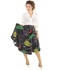 """How amazing is this print?!! We are officially #obsessed! Designer-inspired and oh-so-chic, the skirt's bold contrast and high-fashion vibe will make you stand out in a crowd. High waisted and with a full flare, pair with an equally cute blouse and mod heels. Or, go simple with a black crop top and pumps.      By Re:Named  100% Polyester  Dry Clean Only  Imported   Model Info: Height: 5'6"""" 