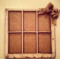 Old window pane with burlap background. put black and white pictures. also hot glue close pins and hang the pictures from that. by cherry
