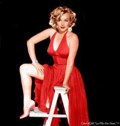 Marilyn Monroe. Red dress sitting. Milton Greene, 1957.