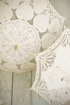 Lace parasols made in Burano, Italy aka Lace Island off of Venice. www.barcelonaweddingstories.com