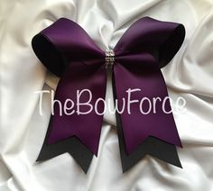 A personal favorite from my Etsy shop https://www.etsy.com/listing/223318689/double-layer-purple-black-cheer-bow
