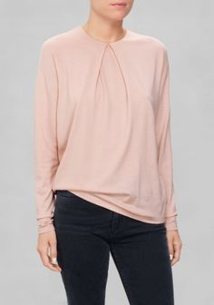 Crafted from fine wool, this understated and simple everyday sweater is detailed with an inverted pleat in the front.