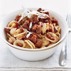 Chef Way Daniel Boulud tops house-made orecchiette (ear-shaped pasta) with a bolognese sauce prepared with venison, pork butt, chicken liver and veal ...