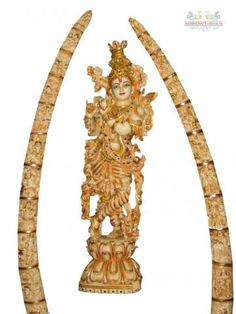 Krishna in its magnificent form to express its emotion made up of marble powder and furnished with golden painting